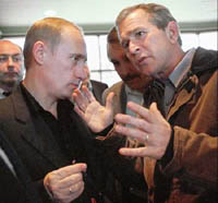 Putin, Bush meet at Moscow airport as U.S. president heads to Asia