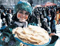 Russians start celebrating a whole week of eating pancakes and laughing