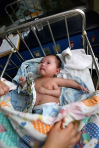 Three-armed baby born in China