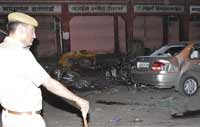 Series of bomb blasts kill at least 80 in India
