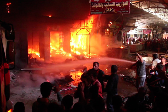 In Mosul market on fire because of shelling. Video. Mosul