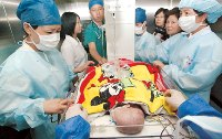 Conjoined twin girls head home after successful separation surgery at Shanghai