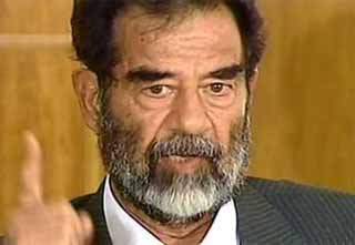 Saddam Hussein  refuses to enter plea as specific charges read against him