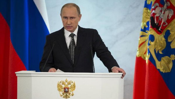 Putin: Russia will never follow instructions from the West. AP photo