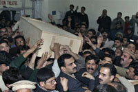 Bhutto funeral: thousands of supporters gather near mausoleum