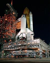 NASA postpones shuttle launch after hail storm pelts Atlantis' external fuel tank
