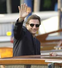 Liam Neeson denies criticizing Madonna's adoption of African boy