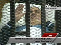 Ailing Hosni Mubarak arrives in helicopter from Cairo hospital for his trial. 45126.jpeg