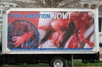 Truck driver accused of displaying images of aborted fetuses on his vehicle
