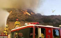 Wildfires in Southern California, killing 1 and destroying several homes and church