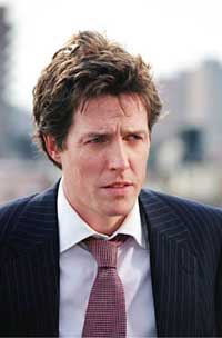 Actor Hugh Grant accepts libel damages from newspapers over relationship claims