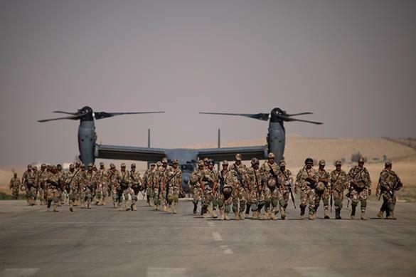 War against ISIL turns into strange spectacle. More US troops in Iraq