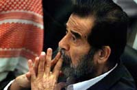 Saddam Hussein attends his genocide trial a day after judge threw him out of courtroom