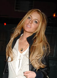 Lohan's former bodyguard sues Star magazine over photos and tell-all article