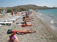 Sunbathing topless not recommended for fatty and not pretty women