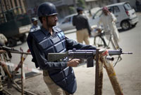 Pakistani Police Attacked in Two Cities