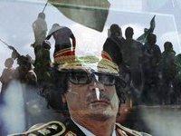 Gaddafi's forces strike bakc at Libyan rebels across Tripoli. 45208.jpeg