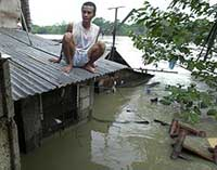 Tropical storm intensifies into typhoon, pounds eastern Philippines with winds, rain