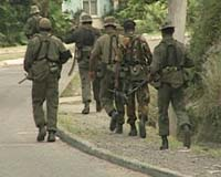 Troops disarm police in Fiji, escalating coup fears