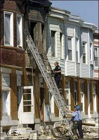 Fire engulfs two-story row house in Baltimore six people killed