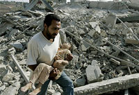 Israel suspends air raids to absorb international indignation over massacre in Qana