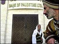 Palestinians attack bank demanding promised salaries