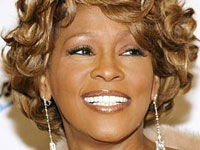 Whitney Houston Brings Her Old Fur Coat for Moscow Show