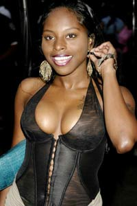 Rapper Foxy Brown charged with striking neighbor with her cell phone