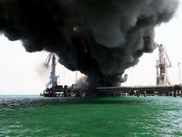 Mexico tries to cope with gas and crude leaks, fires and oil slicks at damaged Gulf oil platform