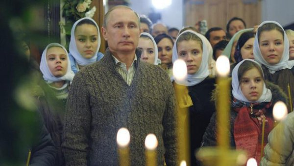 President Putin congratulates all Russians and Orthodox Christians on Christmas. Vladimir Putin attending Christmas ceremony