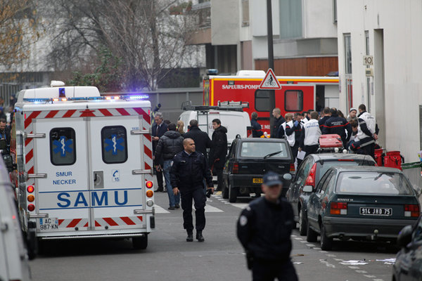 French police hunt for suspects of Charlie Hebdo attack. France mourns victims of Charlie Hebdo attack