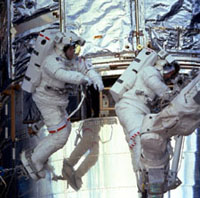 Astronauts connect fluid lines to permanent cooling system during 1st of 3 spacewalks