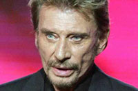 French Rock Star Johnny Hallyday in Drug-Induced Coma After Surgery in Los Angeles