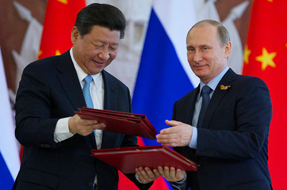 Putin to meet China's Xi Jinping to divide the world and punish USA. 60331.jpeg