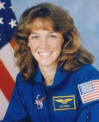 NASA astronaut Lisa Nowak loses her job and returns to Navy