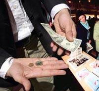 Dollar slides against euro