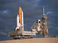 Parts of space shuttle powered down in case extra day is needed at space station