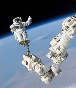 Astronauts conduct spacewalk as shuttle declared safe to return to Earth
