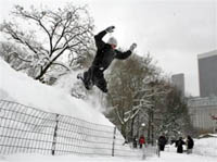 New Yorkers enjoy winter fun as heaps of snow paralyze US North