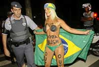 Brazil police clash with protesters demonstrating against Bush visit