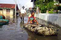 Floods inundate Indonesian capital, swamping markets, hospitals, homes