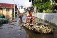 Heavy rain burst riverbanks throughout Indonesia's capital killing 25