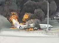 Passenger plane burns and cracks into two in Okinawa airport, everyone escapes
