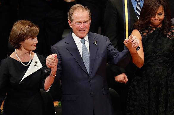 George W. Bush dancing and feeling good at Dallas police funeral ceremony. 58395.jpeg