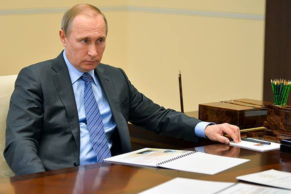 Putin reads into WADA report, asks questions. 58438.jpeg