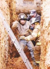 Worker trapped in an 8-foot-deep trench