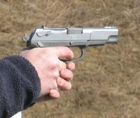 Denied handgun permit, U.S. man accused of office shooting allowed to buy shotgun