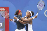 U.S. Open - Day 5: Williams sisters reach 4th round in tournament