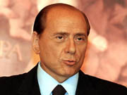 Italy's Berlusconi says he will resign to make way for a Prodi government