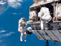 American-Russian astronauts take spacewalk at space station